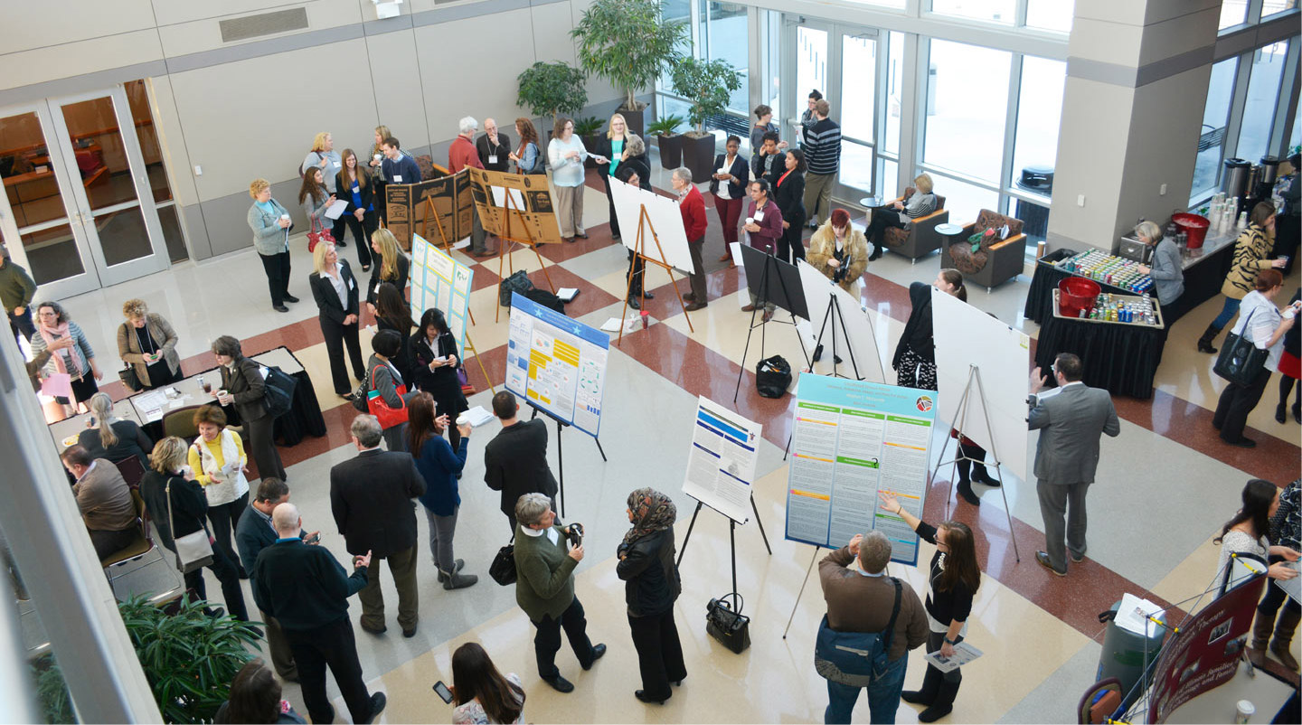 Photo showing attendees viewing posters at the annual IAMFT conference